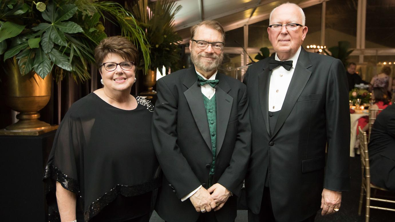 Robert Ritner (center) with Jeanne and John Rowe                    (left and right)