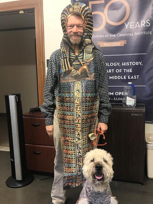 Robert Ritner dressed as a pharaoh for                          Halloween, accompanied by his wheaten terrier                          Sheshonq
