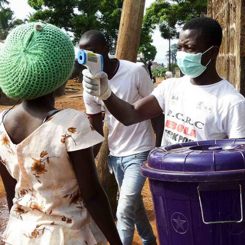 A temperature check at a road block in Lakka, Sierra Leone.