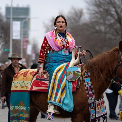 Nina Sanders on horseback in an Apsáalooke parade on the UChicago campus