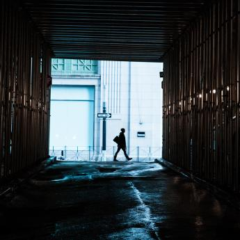 Person walking through alley