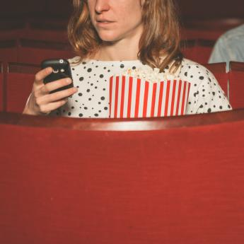 Moviegoers distracted by their cell phones