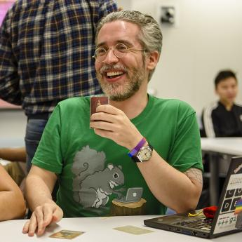 Sr. Lect. Borja Sotomayor plays cards with some of his students during a recent 'Hack Night'