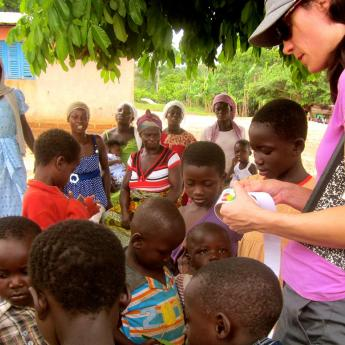 Children in Ghana learning about water quality from wells and streams.