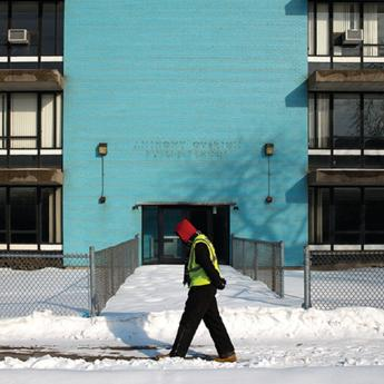 Man walking in front of Overton Elementary School in Bronzeville, one of many schools shuttered during Chicago's wave of school closings in 2013.