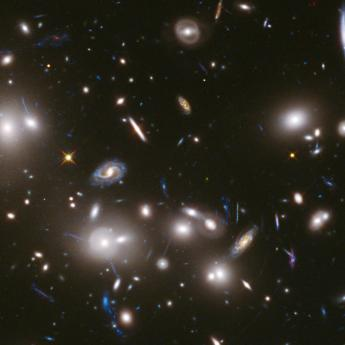 Telescope image of dozens of galaxies clustered in space