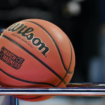 A Wilson basketball rests on a rack during the NCAA men's basketball tournament