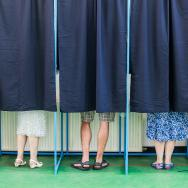 People cast votes in a polling booth