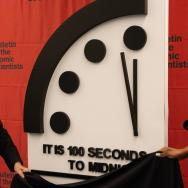Bulletin of Atomic Scientists board members Robert Rosner and Suzet McKinney pull cloth away to reveal 2021 Doomsday Clock